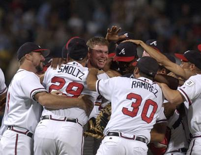 Atlanta Braves' Chipper Jones, center, without hat, celebrates with teammates after the Braves clinched their 13th straight division title with an 8-7 win over the Florida Marlins on Friday, Sept. 24, 2004, in Atlanta.